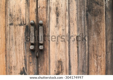 Old wooden door and old wooden handle in thai style. - stock photo