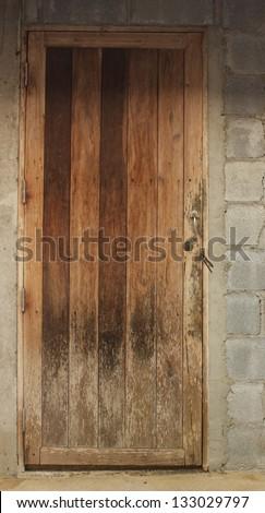 Old wooden door at the kitchen door - stock photo