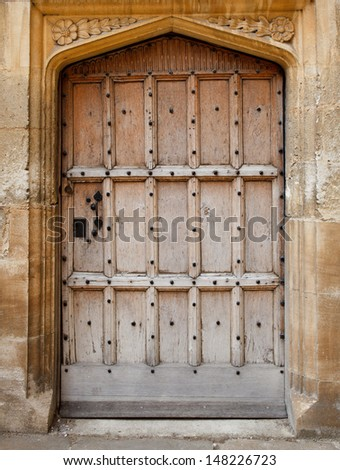 Old wooden door background (Bodleian library, Oxford) - stock photo