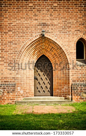 old wooden door in a castle - stock photo