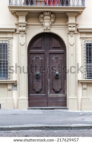 Old wooden door in Italy, Europe - stock photo