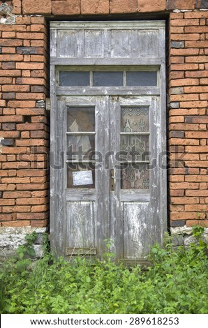 Old wooden door on abandoned home, Bulgaria, Europe