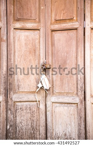 old wooden door panel chinese style with master key on hinge  - stock photo