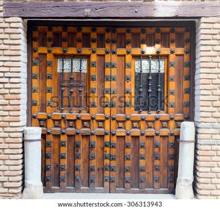 old wooden door with iron ornaments - stock photo