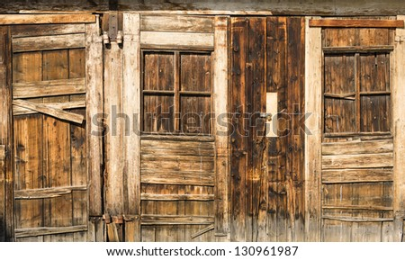 old wooden doors in a row - stock photo