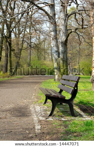 old wooden empty park bench - stock photo