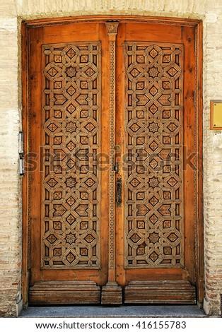 Old wooden entrance door in Toledo, Spain - stock photo