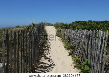 Old wooden fence, beach access  in Ile d'Yeu Island, Vendee, France - stock photo