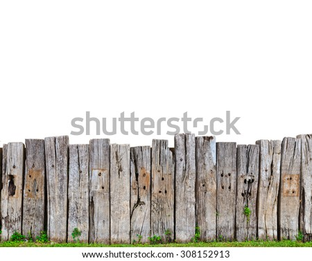 old wooden fence in garden with plant - stock photo