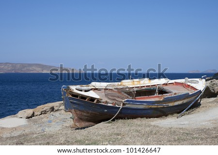 Old wooden fisher boat in Agia Anna, Mykonos , Greece - stock photo