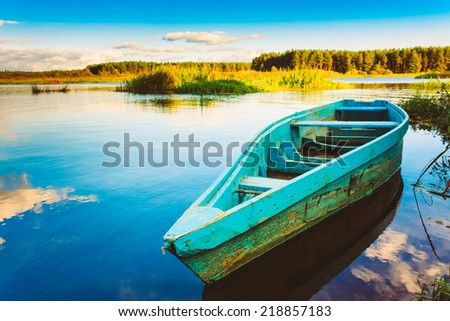 Old Wooden Fishing Boat In River.   - stock photo