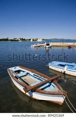 Old wooden fishing boats berthed in the Sukosan port - stock photo