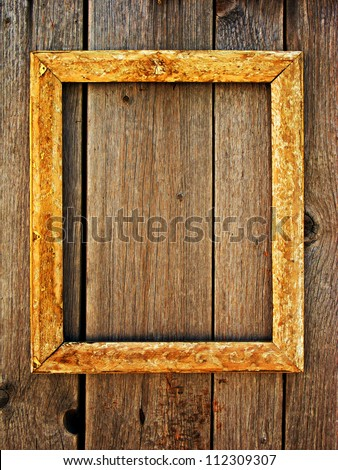 Old wooden frame on a wooden wall - stock photo