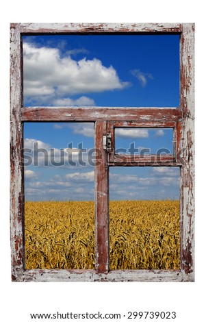 old wooden frame, wheat field and the blue sky - stock photo