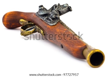 Old wooden gun, upper side, selective focus, on white background. - stock photo