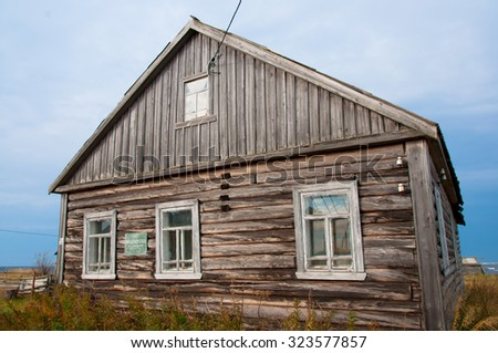Old wooden house deep in nussian north. - stock photo