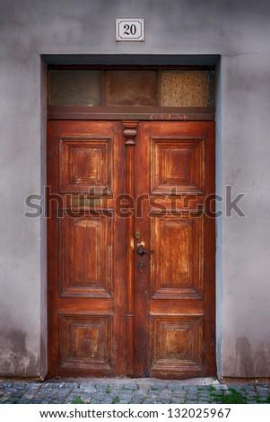 old wooden house Door in city Pardubice - stock photo