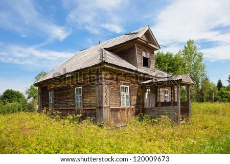 Old wooden house in russian village. Novgorod region, Russia. - stock photo