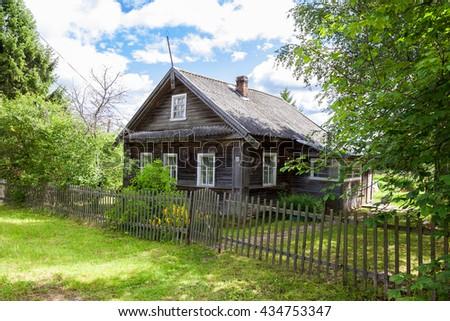 Old wooden house in russian village. Novgorod region, Russia - stock photo