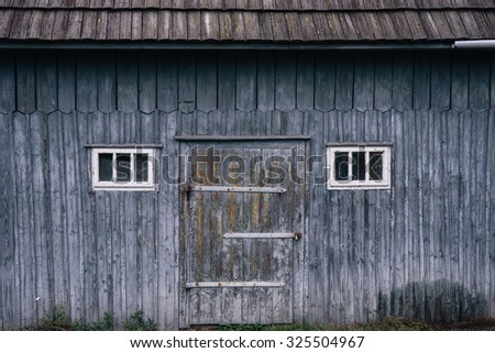 Old wooden house, old timber house; Log house front view - stock photo