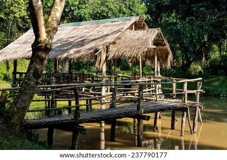 Old wooden house on the river - stock photo