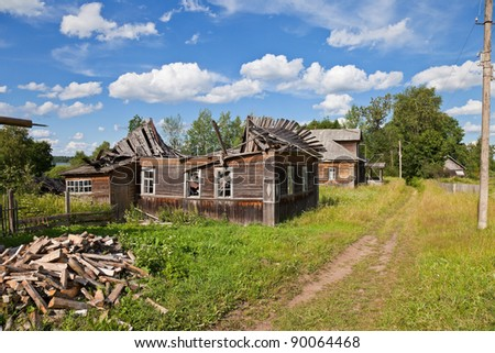 Old wooden houses in russian village - stock photo