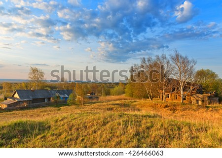 Old wooden houses on hill in deserted village. - stock photo
