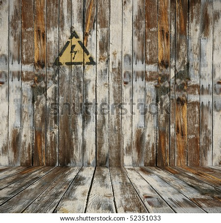 old wooden interior with voltage sign - stock photo