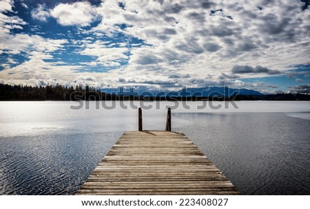 old wooden jetty at a lake - stock photo