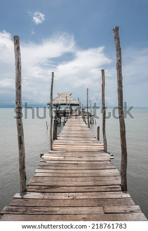"""Old wooden jetty at Kood island, Thailand.Kood island is the most beautiful island in eastern thailand,In thai people call """"Koh kood"""" - stock photo"""