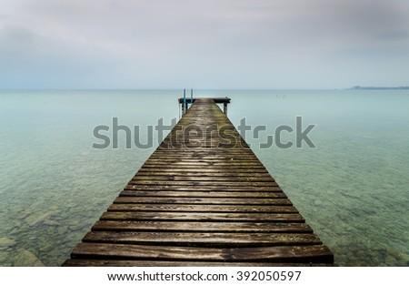 old wooden jetty at Lake Garda, Italy - stock photo