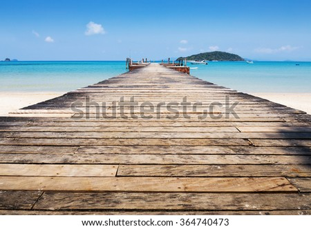 Old wooden jetty on exotic beach Koh Chang island, Thailand - stock photo