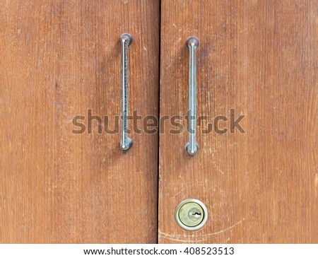 Old wooden lockers with metal handle in vintage style. - stock photo