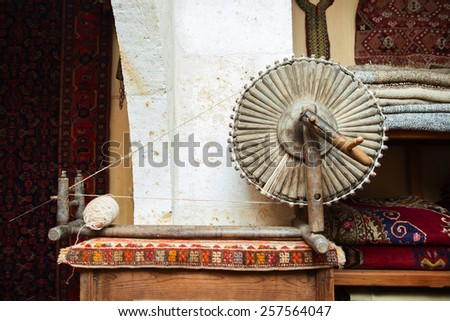 old wooden machine for produce traditional rug - stock photo