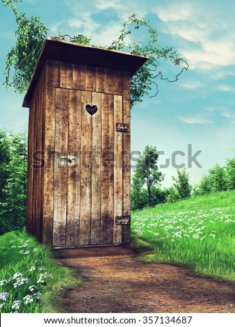 Old wooden outhouse on a meadow near a forest - stock photo