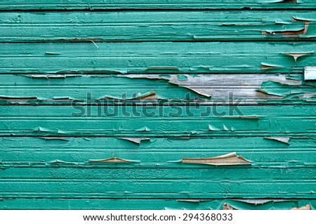Old wooden painted blue-green textured background with peeling paint  - stock photo