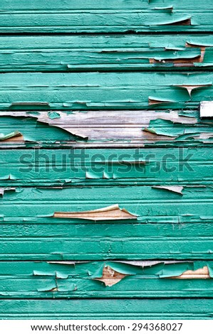Old wooden painted green textured background with peeling paint  - stock photo