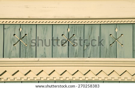 Old wooden painted light blue rustic background with carved elements and cracked paint - stock photo