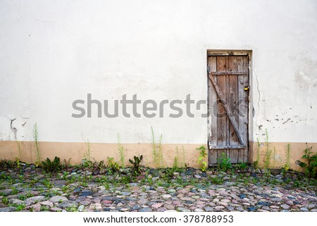 Old wooden plank door of a abandoned house - stock photo
