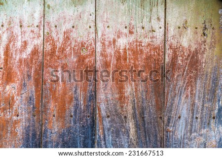 Old wooden plank painted of various colors - stock photo
