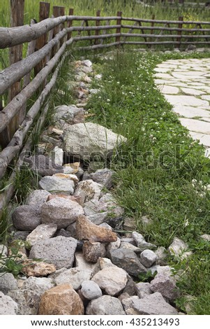 old wooden rural fence in the village, natural background - stock photo