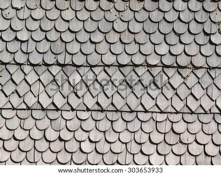 Old wooden shingle facade, detail - stock photo