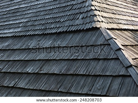 Old wooden shingle roof with rich texture. - stock photo