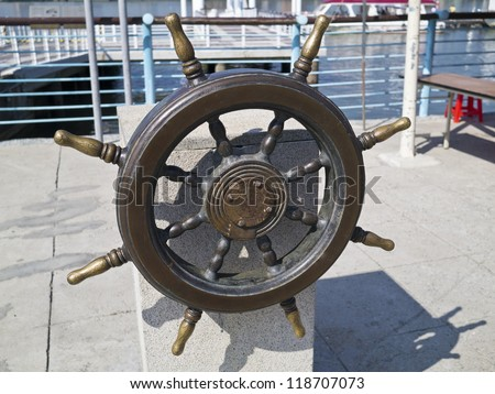 old wooden ships helm wheel - stock photo