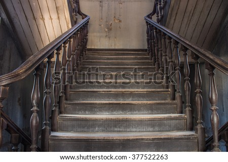 old wooden staircase railing. handrails, balusters and stair old wooden stairs - stock photo