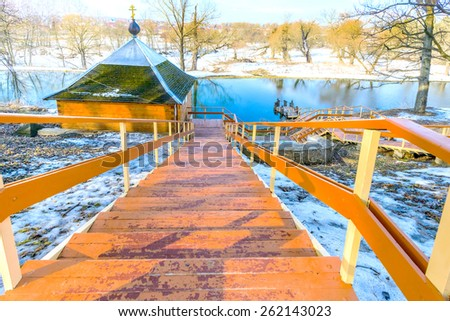 old wooden stairs to the nature of the park in early spring - stock photo