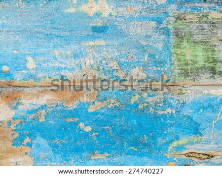 old wooden surface with paint blistering off - stock photo