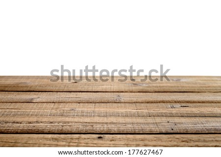 Old wooden table isolated on white background. Shallow depth of field - stock photo