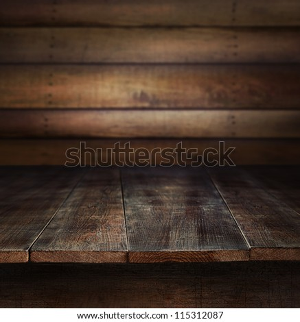 Old wooden table with wooden background - stock photo