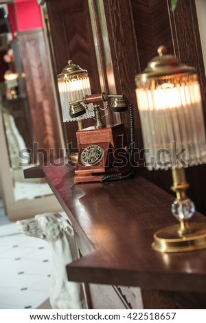 old wooden telephone on the wooden table - stock photo